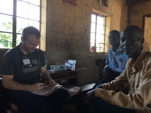 Dr. Luke Husby evaluating a patient in a mobile clinic in rural Uganda.